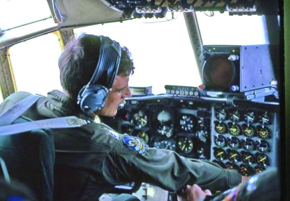Capt. Jack Hudspeth at ease behind the controls of a C-130 transport plane.