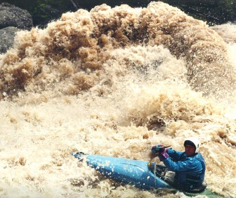 Peak flow in 1997 pushed water over House Rock, challenging boaters like Kevin Kelleher.