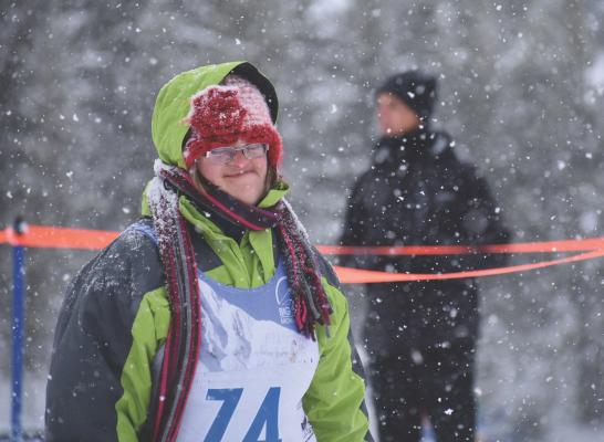 Special Olympian Skye Breitenfeldt rounds the corner during the afternoon snowshoe races. PHOTO BY JOLENE PALMER