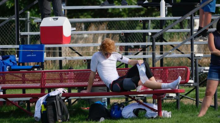 Freshman Bennett Miller ices his knee after injuring it against Park City.