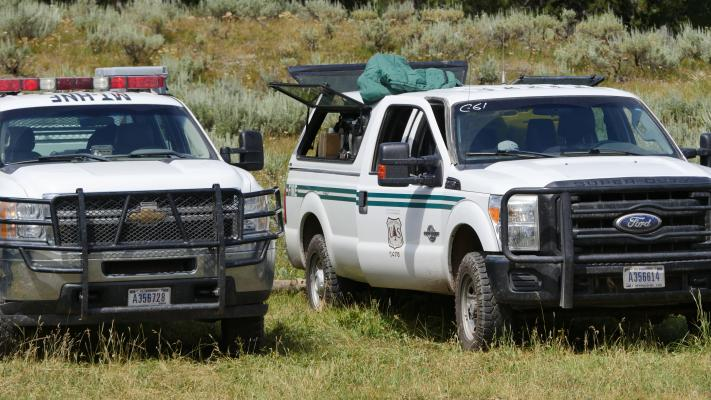 Crew trucks from Custer Gallatin National Forest.