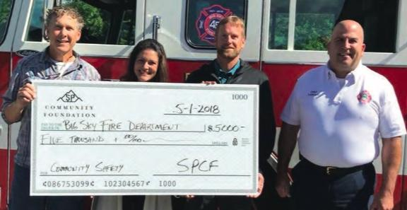 A special thank you to the Spanish Peaks Community Foundation for their generous donation. These funds will go towards the purchase of new extrication equipment for the department. (L to R) John Haas and Louise Astbury representing the Foundation, Big Sky Fire District Board Chair Alan McClain and Fire Chief William Farhat. Farhat offered updates about fire protection in Spanish Peaks at the October board meeting.