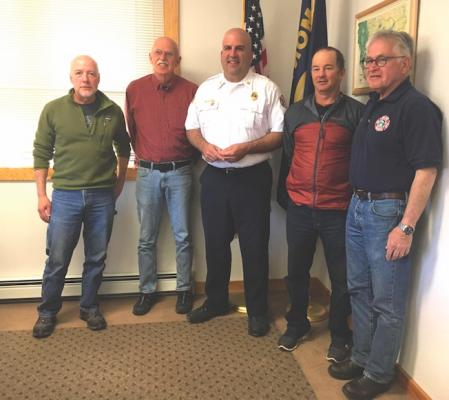 During the Big Sky Fire Department Board of Directors meeting on April 27, Chief Bill Farhat recognized four members of the team for their service as they head off to other callings. From left to right: Tom Reeves, BSFD board trustee, Rich Piercy, BSFD EMT, Bill Farhat, Bart Mitchell, BSFD captain, and Steve Johnson, BSFD board trustee.