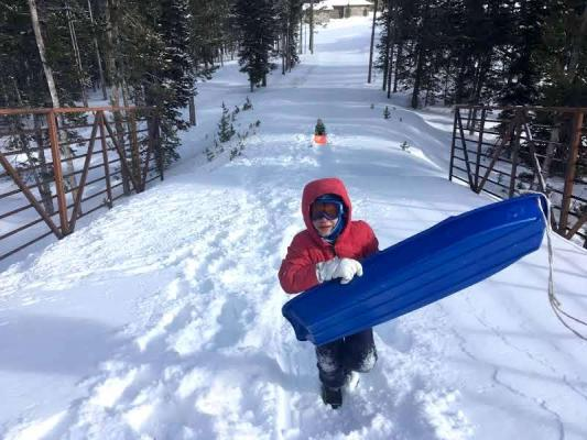 A seemingly innocuous day of sledding quickly turned serious when Big Sky youngster Elijah Brauer suffered a brain injury after hitting a tree. He was flown to Salt Lake for treatment, and is now back to his regular antics, but his parents want to spread the word that helmets really can save lives.