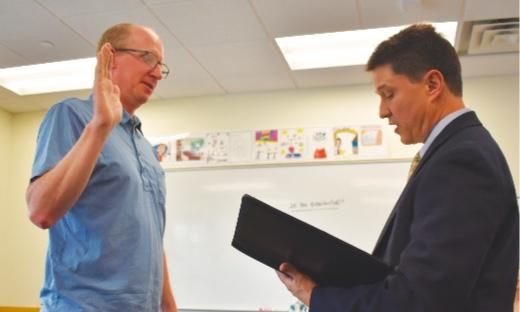 The third time's a charm—Matt Jennings (left) was sworn in by Gallatin County School Superintendent Matthew Henry for Jennings' third three-year term as a Big Sky School District Board of Directors trustee.