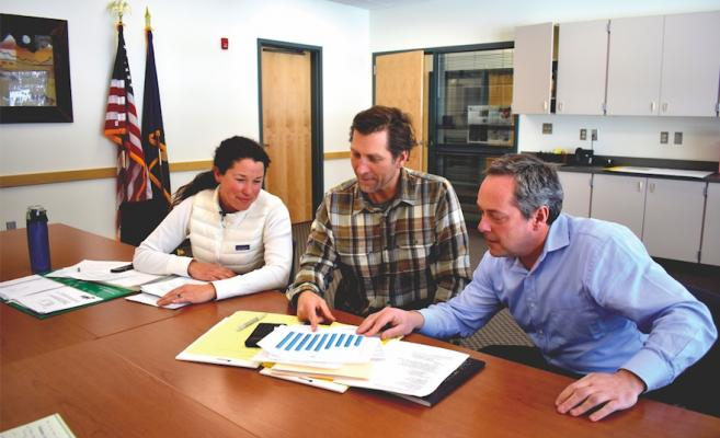 (L to R) Big Sky School District Trustee Whitney Littman, District Business Manager Corky Miller and Superintendent Dustin Shipman analyze budget numbers and levy language. Their district will request for a $40,000 general fund levy on the ballot this May.