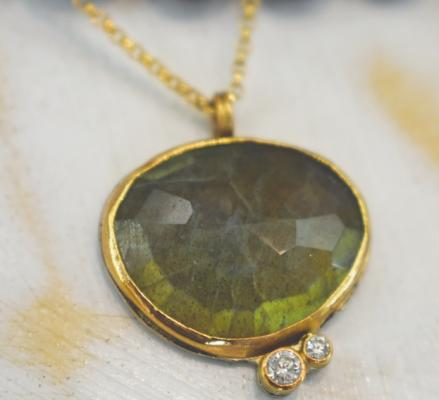 "Labradorite, one of the bestselling gemstones at Ari O, is featured in this necklace. ""It's perfect, because it's a protective stone,"" Coleman said, noting that many of her customers are interested in the healing properties of the stones she sells."