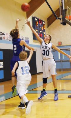 Austin Samuels tries a baseline floater against Shields Valley JV.
