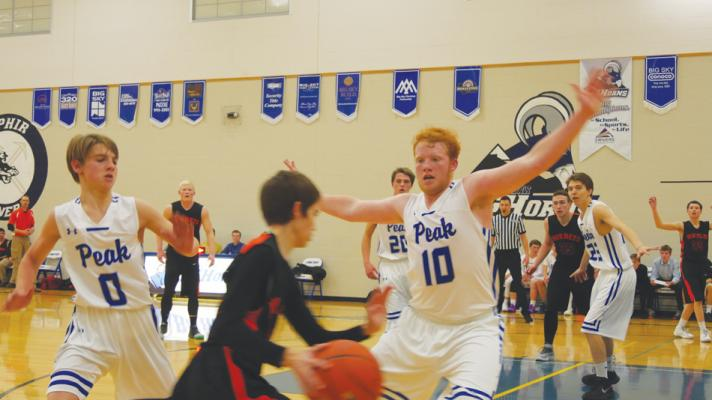 Austin Samuels, Liam Germain, Jackson Wade and Brayden Vaile zero in on a Hornet player from White Sulphur Springs.