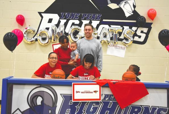 It's off to Kansas for Jayleen Cole to study and play at Coffeyville Community College. Her grandmother Linda (left) and aunt/high school coach Ausha Cole (holding infant) gathered on April 26 to celebrate.