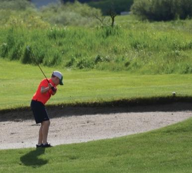 A junior golfer plays the Big Sky Resort Course, where in August, some of the best young players in the country will compete.