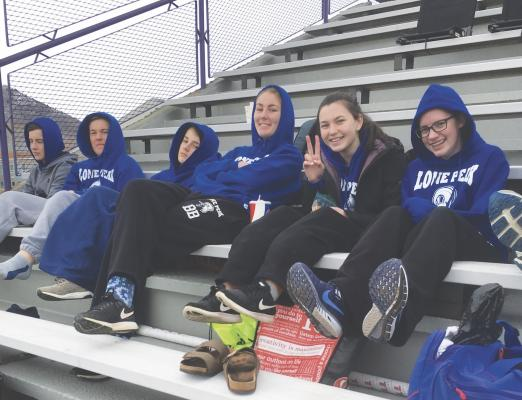 Members of the Lone Peak High track team take a break from competition during the first meet of the season in Butte on April 14. Many of the athletes were away for the beginning of spring break. With good weather in the forecast, the team will be out in full-force for an upcoming meet in Bozeman.