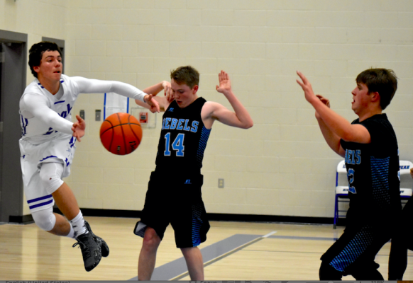 Junior Nick Brester keeps it inbounds. Brester brought home four points for his team on December 20.