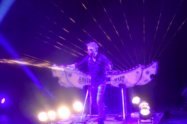 William Close plucks the strings of his Earth Harp.
