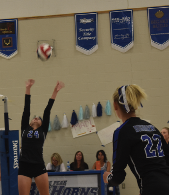 #24 Ivy Hicks assists for the kill. PHOTO BY JANA BOUNDS