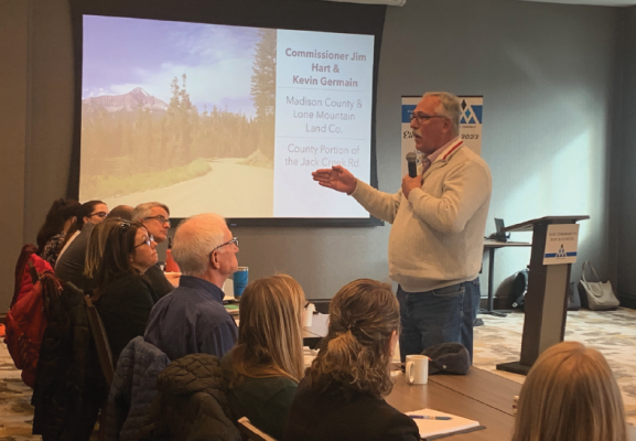 Commissioner Jim Hart picked-up the microphone and approached the crowd to discuss the complexities of the Jack Creek Road issue at the Nov. 6 Madison and Gallatin Counties Joint Commission meeting . PHOTO BY JANA BOUNDS PHOTO BY JANA BOUNDS