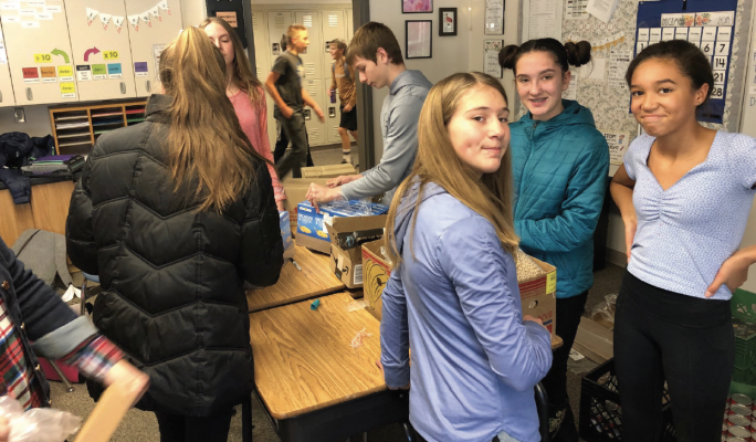 8th grade students construct the recycling centers for Ophir Elementary School. PHOTO COURTESY LAURA SEYFANG