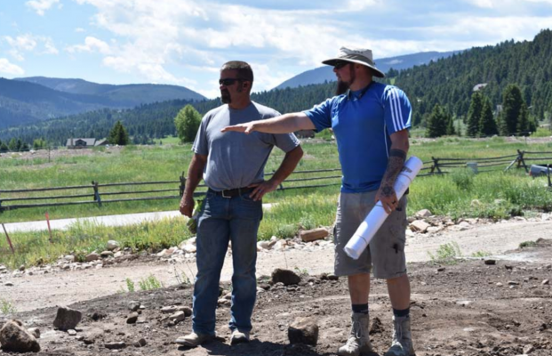 Justin Provance (R) discusses the lay of the land with TLC excavation heavy equipment operator Mark Greisen (L). PHOTO BY JANA BOUNDS