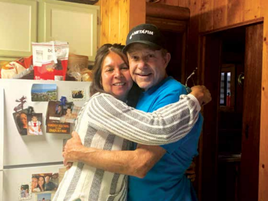 """Rhonda and Paul """"Cap"""" Caprioglio know the history of every corner of the cabin that is their summer home. Cap's parents breathed life into it. PHOTO BY JANA BOUNDS"""