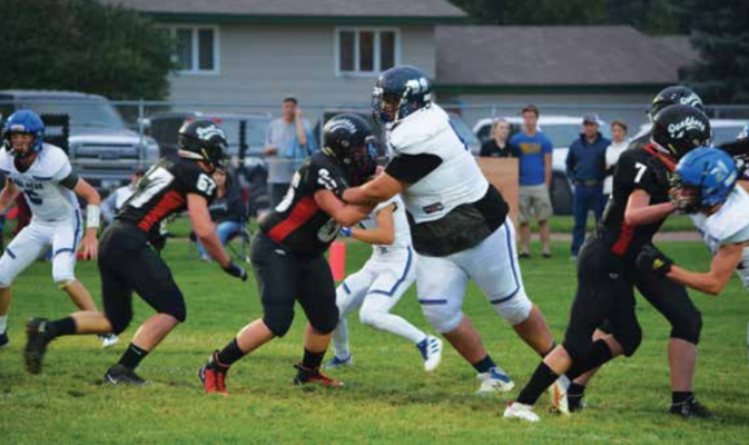 Big Horns Varsity Right guard Kole Maus dominates on the field against the Park City Panthers. PHOTO COURTESY KIM HOLST