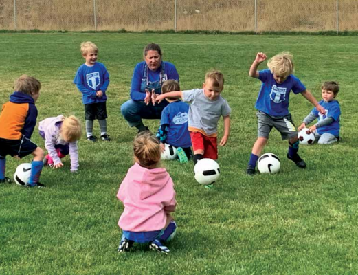 Big Sky Futbol Club minis learn soccer basics from Renee Zimmerman. Photo by Jana Bounds
