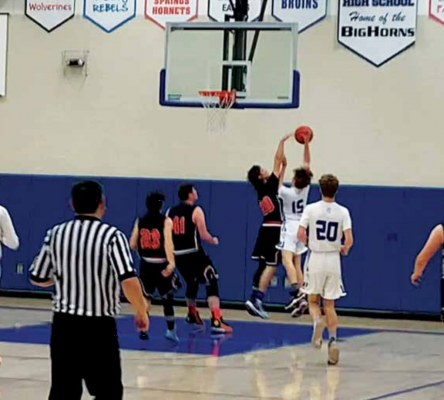 Senior Michael Romney takes a shot against the Hornets. The Big Horns had an offensive rally in the second half. PHOTO BY JANA BOUNDS