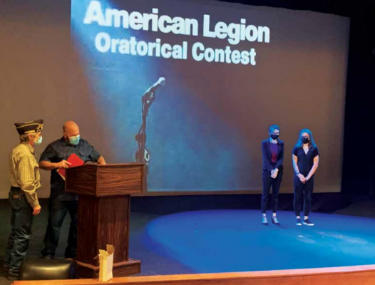"""American Legion Post 99 member Kenny """"Cuz"""" Alley and Sons of the American Legion member and Master of Ceremonies Tony Coppola award Ella Henslee first place and Avery Dickerson second place in the Oratorical Contest. PHOTO BY JANA BOUNDS"""