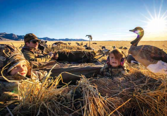 """I grew up hunting and enjoying the outdoors lifestyle. Now, Montana is a whole other sportsman's paradise. My love for it in the Midwest increased 10-fold when we moved out here,"" Deputy Fire Chief Dustin Tetrault said. Now, he has little hunting helpers: Avery and Blakelyn – pictured duck hunting with their dad. PHOTO COURTESY OF DUSTIN TETRAULT"