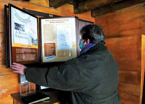 Mistretta flips through the panel display inside the Historic Crail Ranch Museum. She conducted the research for the displays herself and was assisted by an outside contractor, Glenniss Indreland, who helped design the displays. PHOTO BY KEELY LARSON