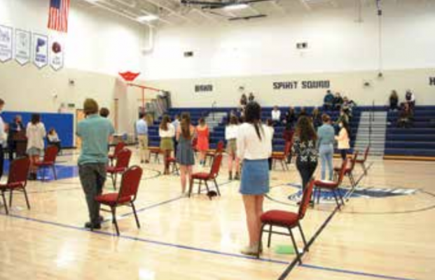 At the prompting of Superintendent Dr. Dustin Shipman, students stand to applaud their donors, the FOBSE board, their families and the community that raised them at the end of the ceremony. PHOTO BY KEELY LARSON