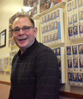 Dr. Jeff Daniels lets his medical student staff handle things for a moment while he takes a walk down memory lane. He's saved each of his nearly 900 interns' ski passes and showcases them on the walls at the newly named Bozeman Health Mountain Clinic.