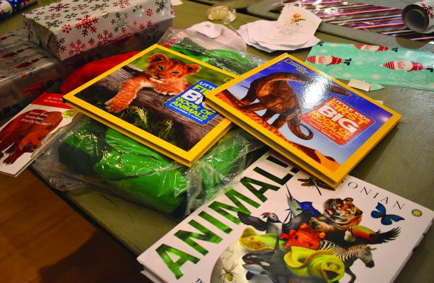 These books were just a few of the many gifts donated to Big Sky kids via the Big Sky Rotary's Christmas Giving Tree program last year. The annual program is back again this year, and the community will soon be able to drop by the Big Sky Post Office to check out the Christmas tree decorated with ornaments describing the Christmas gift wishes of a local youngster.