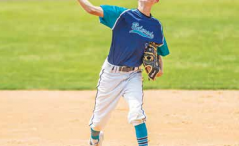 Sid Morris hurls the ball to first base to get the runner. PHOTO COURTESY DAVE PECUNIES