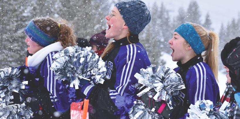 Lone Peak High School cheerleaders Sophia Cone, Abi Hogan and Tristen Clack let their voices echo through the Madison Base Area of Big Sky Resort on Monday, Feb. 26, cheering on the dozens of Special Olympians as they compete.