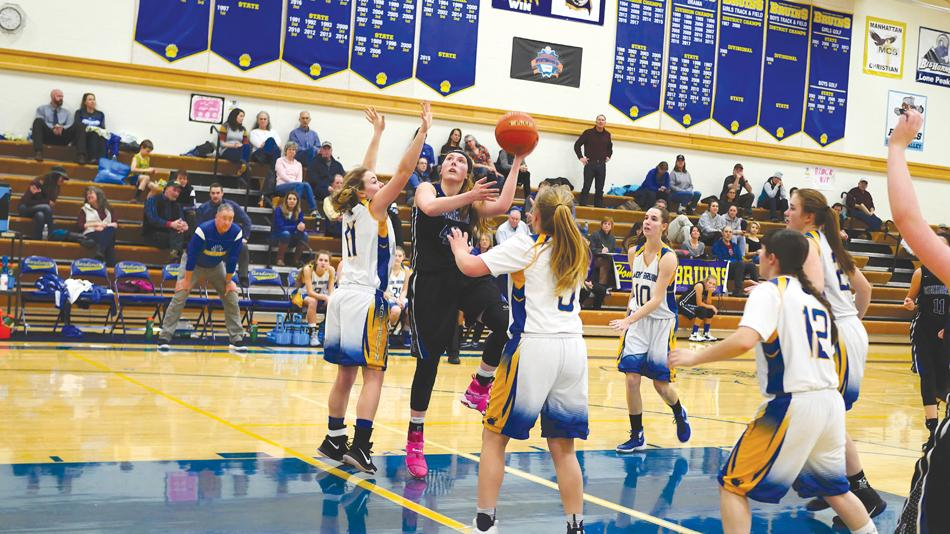 KP Hoffman powers over the Bruin defense in a close one at Gardiner. When Hoffman wasn't hitting in the paint, she was sinking crucial free throws. She recently committed to play next year at Miles City Community College.