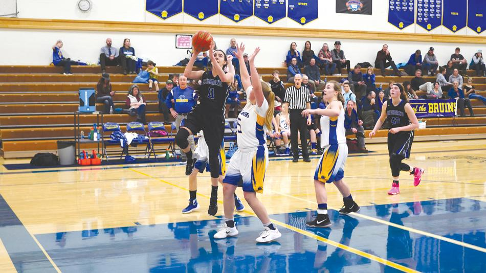 Before getting sidelined with an injury, Emma Flach drives to the basket against Gardiner.