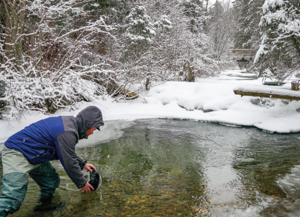 Jack Creek Selfie. This image of Coyle in Jack Creek with his underwater housing was shot on a timer with his camera set up on a tripod. He had been trying to capture a winter scene of the creek, emphasizing the ice that can build up on the rocks at the bottom.