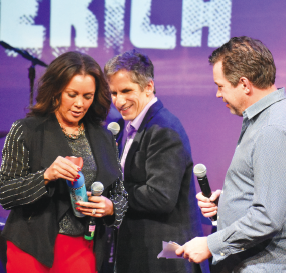 "Vanessa Williams hands a ""breath of fresh air"" to James Wesley. WMPAC staff came in with a clutch bottle of oxygen for Wesley when he realized after performing ""A Piece of Sky"" those long notes hit you harder in the mountains."