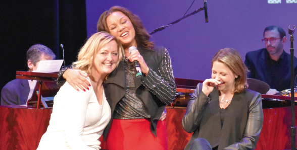 """Sometimes the snow comes down in June..."" Sarah Phelps and Jane Mooney were serenaded by Vanessa Williams as she sang ""Save the Best for Last"" as part of an auction to raise more money for the concert's causes."