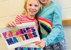 Ophir third graders Sabine Hurlbut (left) and Pearl Goldberg show off their artwork, which will become part of a larger quilt. PHOTO COURTESY OF BSSD