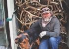 Craig Krzycki and his dog Elmer by an impressive stash of raw material.
