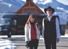 Big Sky Shuttle owner Tracy Pabst and one of her drivers, Bruce, stand with a BSS luxury touring coach. Pabst hopes her donations from this winter's luxury coach sales to the Gallatin River Task Force will motivate other Big Sky businesses to follow suit, offering up a portion of their proceeds to a charity of their choice.