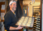 Blue Moon Bakery General Manager Chris Rouse boils bagels. It's a night preparation for early mornings at the Blue Moon Bakery.