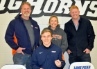 Brett, Kegan, Kim Babick and LPHS head football coach Adam Farr are all smiles as Kegan just signed a letter of intent to play football for the only school to which he applied – Wheaton College.