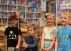 Levon Wilson, Connor Ruuhela, Ava Van Eps and Dylan Frederick celebrate reading 1,000 books before kindergarten.