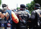 """(L-R) A Rolling Thunder member assists Ronnie """"Crazy Cajun"""" Davis to the Vietnam Memorial Wall so he can honor the men from his platoon, then Rolling Thunder Chapter 1, MO. President Terry """"Tiny"""" Willey also supports Davis. PHOTO BY JANA BOUNDS"""