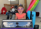 For four-year-old Charlotte, nothing says happiness like cruising around in her purple Jeep on a sunny day. PHOTO BY JANA BOUNDS