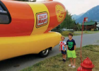 Steen and Russell Mitchell pictured in front of the iconic Oscar Mayer Wienermobile when it visited Big Sky. The Wienermobile has a history dating back to 1936. PHOTO COURTESY OF CAROL COLLINS